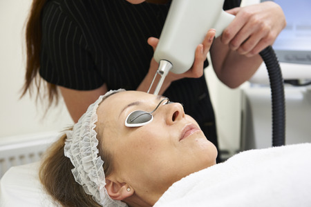 fractional: Beautician Carrying Out Fractional Laser Treatment