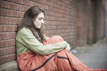 homeless person: Vulnerable Teenage Girl Sleeping On The Street