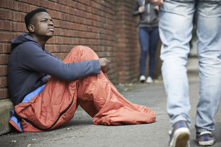 teenage male: Homeless Teenage Boy In Sleeping Bag On The Street