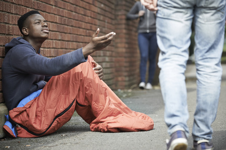 poverty: Homeless Teenage Boy Begging For Money On The Street