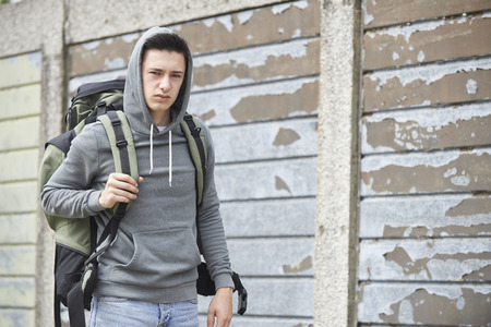 homeless person: Homeless Teenage Boy On Street With Rucksack