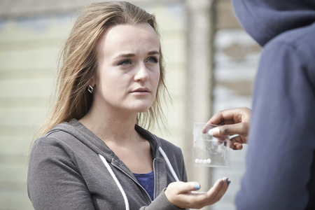 drug: Teenage Girl Buying Drugs On The Street From Dealer