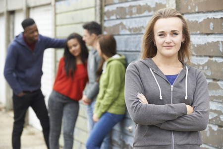 teenage guy: Group Of Teenage Friends Hanging Out In Urban Setting Stock Photo