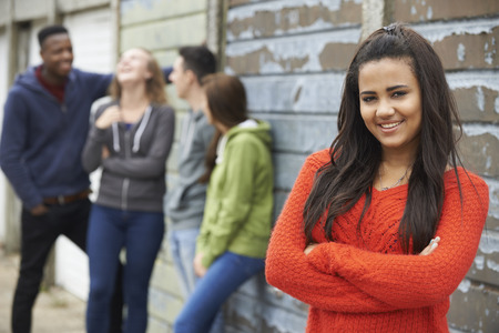 18 year old: Group Of Teenage Friends Hanging Out In Urban Setting Stock Photo