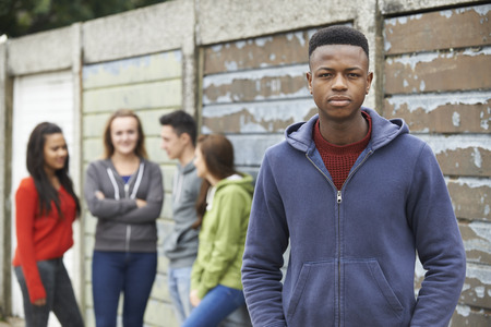 upset: Gang Of Teenagers Hanging Out In Urban Environment Stock Photo