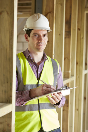 high visibility: Building Inspector Looking At New Property Stock Photo