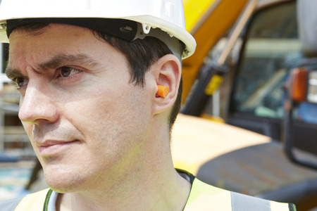 ear protection: Construction Worker Wearing Protective Ear Plugs
