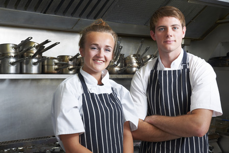 chefs whites: Portrait Of Chef And Trainee In Kitchen Stock Photo