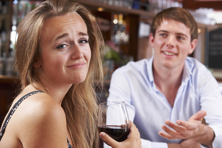 unsuccessful: Couple On Unsuccessful Blind Date In Restaurant