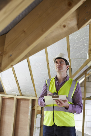 waistcoat: Building Inspector Looking At New Property Stock Photo