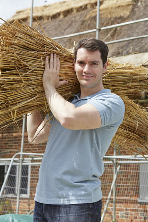 wicker work: Thatcher Carrying Bundles Of Reeds Working On Roof