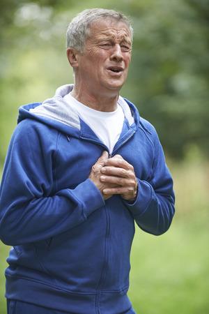 whilst: Senior Man Suffering Heart Attack Whilst Jogging