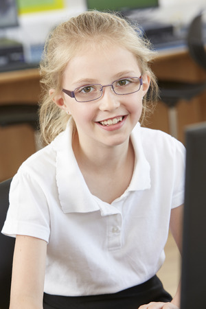 pupil: Female Elementary School Pupil In Computer Class