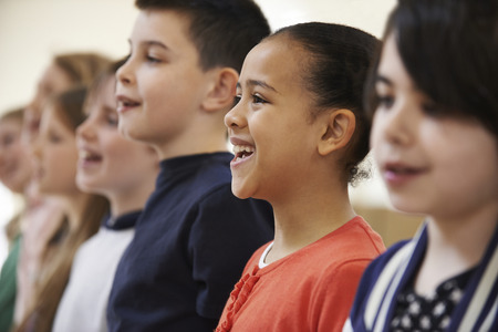churches: Group Of School Children Singing In Choir Together