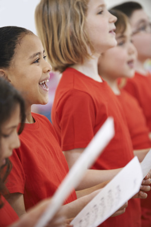 musical: Group Of Children Singing In Choir Together Stock Photo