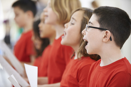 church: Group Of School Children Singing In Choir Together
