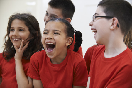 laughing girl: Group Of Children Enjoying Drama Class Together