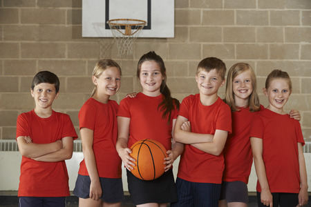 basketball team: Portrait Of School Basketball Team In Gym Stock Photo