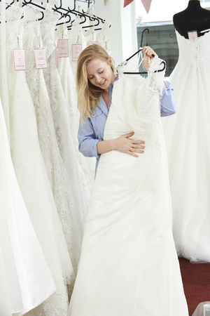 woman dress: Bride Choosing Dress In Bridal Boutique