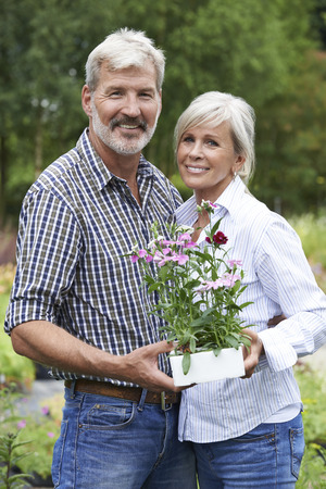 garden center: Portrait Of Mature Couple Shopping At Garden Center