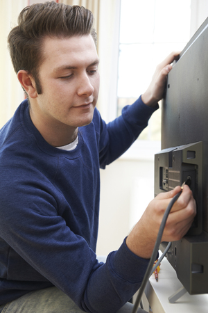 cable tv: Television Engineer Installing New Television At Home