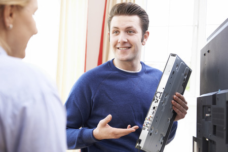 cable TV: Engineer Giving Advice On Installing Digital TV Equipment Stock Photo