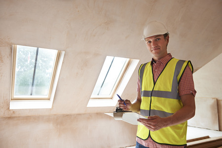 house inspection: Building Inspector Looking At New Property Stock Photo