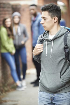 intimidated: Teenage Boy Feeling Intimidated As He Walks Home