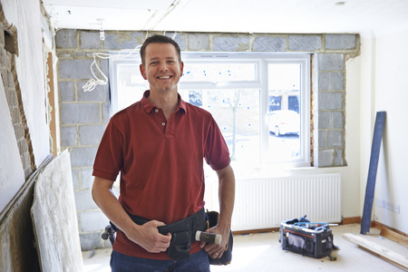 home builder: Portrait Of Builder Carrying Out Home Improvements Stock Photo
