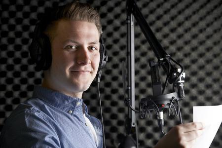 recording studio: Man In Recording Studio Talking Into Microphone