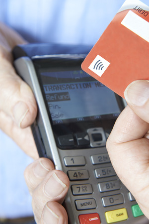 contactless: Customer Making Purchase Using Contactless Payment