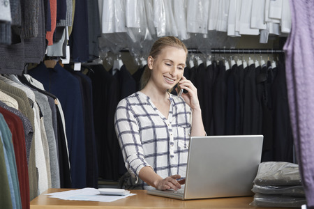 small business owner: Businesswoman Running On Line Fashion Business On The Phone