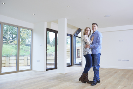 property ladder: Portrait Of Happy Young Couple In New Home