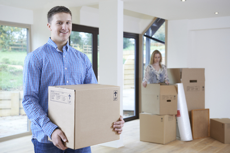 property ladder: Young Couple Moving Into New Home Together