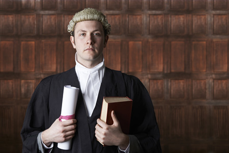 lawyer in court: Portrait Of Lawyer In Court Holding Brief And Book
