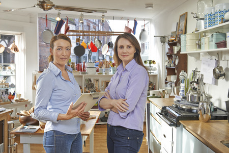 homeware: Portrait Of Two Women Running Cook Shop Together