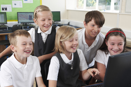 elementary: Group Of Elementary Pupils In Computer Class