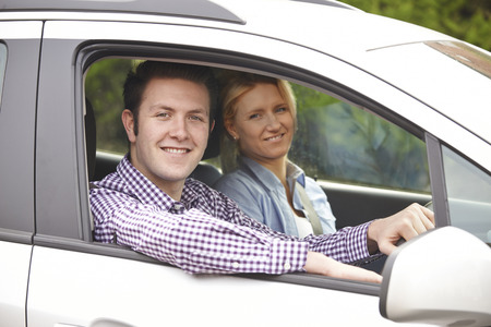 looking out: Portrait Of Young Couple Looking Out Of Car Window Stock Photo