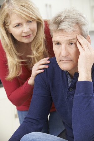 consoling: Mature Woman Comforting Man With Depression