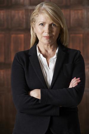 authority: Portrait Of Mature Businesswoman In Boardroom