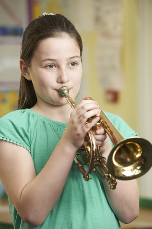 Girl Learning To Play Trumpet In School Music Lesson Zdjęcie Seryjne