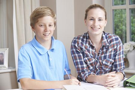 boy 12 year old: Female Home Tutor Helping Boy With Studies