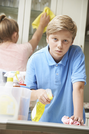 domestic life: Unhappy Children Helping to Clean House Stock Photo