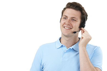 service man: Man Answering Calls In Customer Service Department Stock Photo