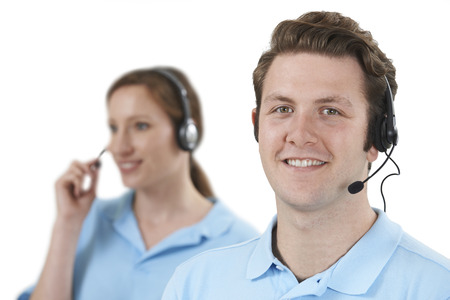 service man: Staff Answering Calls In Customer Service Department Stock Photo