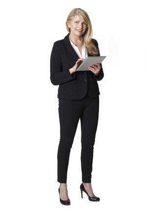 white person: Studio Portrait Of Mature Businesswoman Holding Digital Tablet