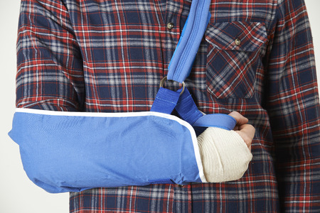 broken arm: Close Up Of Young Man With Arm In Sling Stock Photo