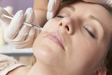 lips close up: Woman Having Injection In Lips As Beauty Treatment