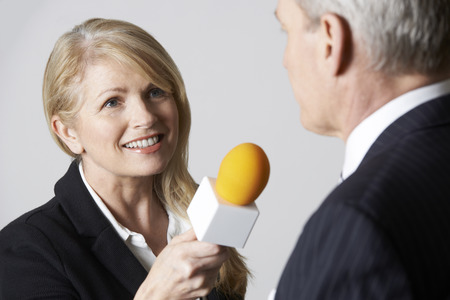 congressman: Female Journalist With Microphone Interviewing Businessman Stock Photo