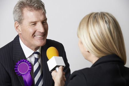 interviewed: Politician Being Interviewed By Journalist During Election Stock Photo